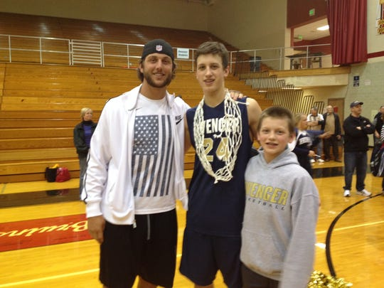 Tyler Eifert (left) and Griffin Eifert (right) with Grady after a Dwenger victory his senior year.
