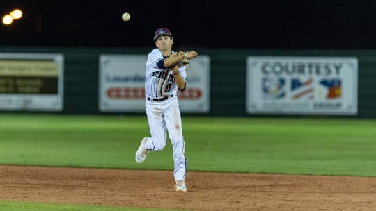 Luke Acosta throws the runner out at first as St Thomas More takes down Teurlings. Tuesday, March 26, 2019.