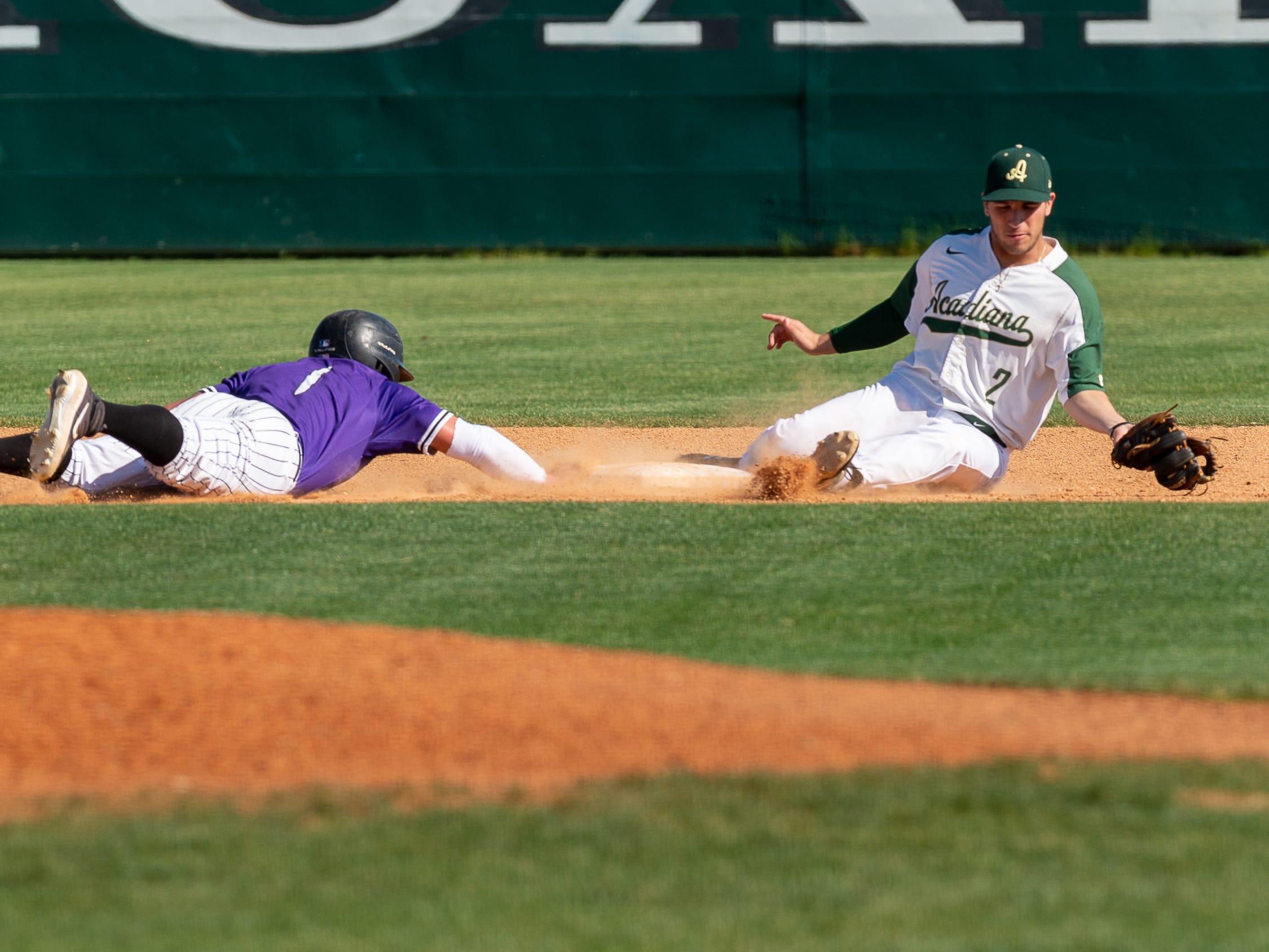 Garrett Felix covers second as Acadiana takes on Sam Houston baseball. Tuesday, March 26, 2019.
