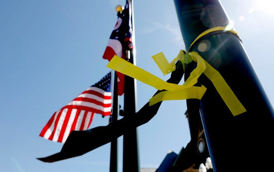 Yellow and black ribbons flutter in the breeze Wednesday, March 27, 2019, in downtown Lancaster as flags remain at half staff for U.S. Army Spc. Joey Collette. Collette, 29, from Lancaster, was killed March 22 in Afghanistan.