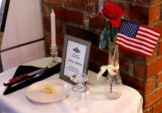 A table setting in honor of Army Spc. Joey Collette sits near the entrance to Texas Roadhouse restaurant in Lancaster. Collette, 29, an explosive ordnance disposal specialist died in Afghanistan Friday, March 22.