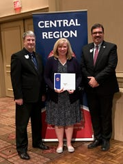 Walnut Township Board of Education President Karen Keller received the Award of Achievement at the OSBA Central Region Spring Conference.