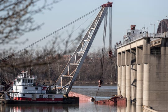 Work continues on the removal of the last two barges that capsized at the McAlpine Locks and Dam in December. March 27, 2019.