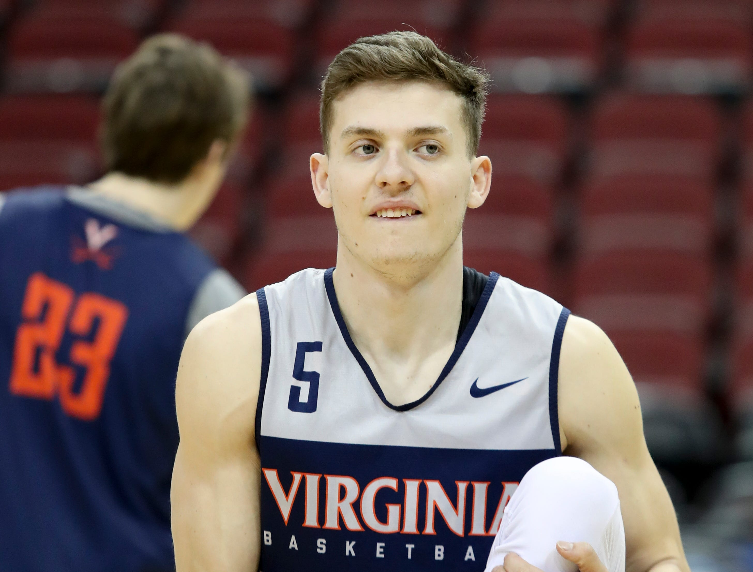 Virginia's Kyle Guy warms up during practice on March 27 at the KFC Yum Center in Louisville, Ky.