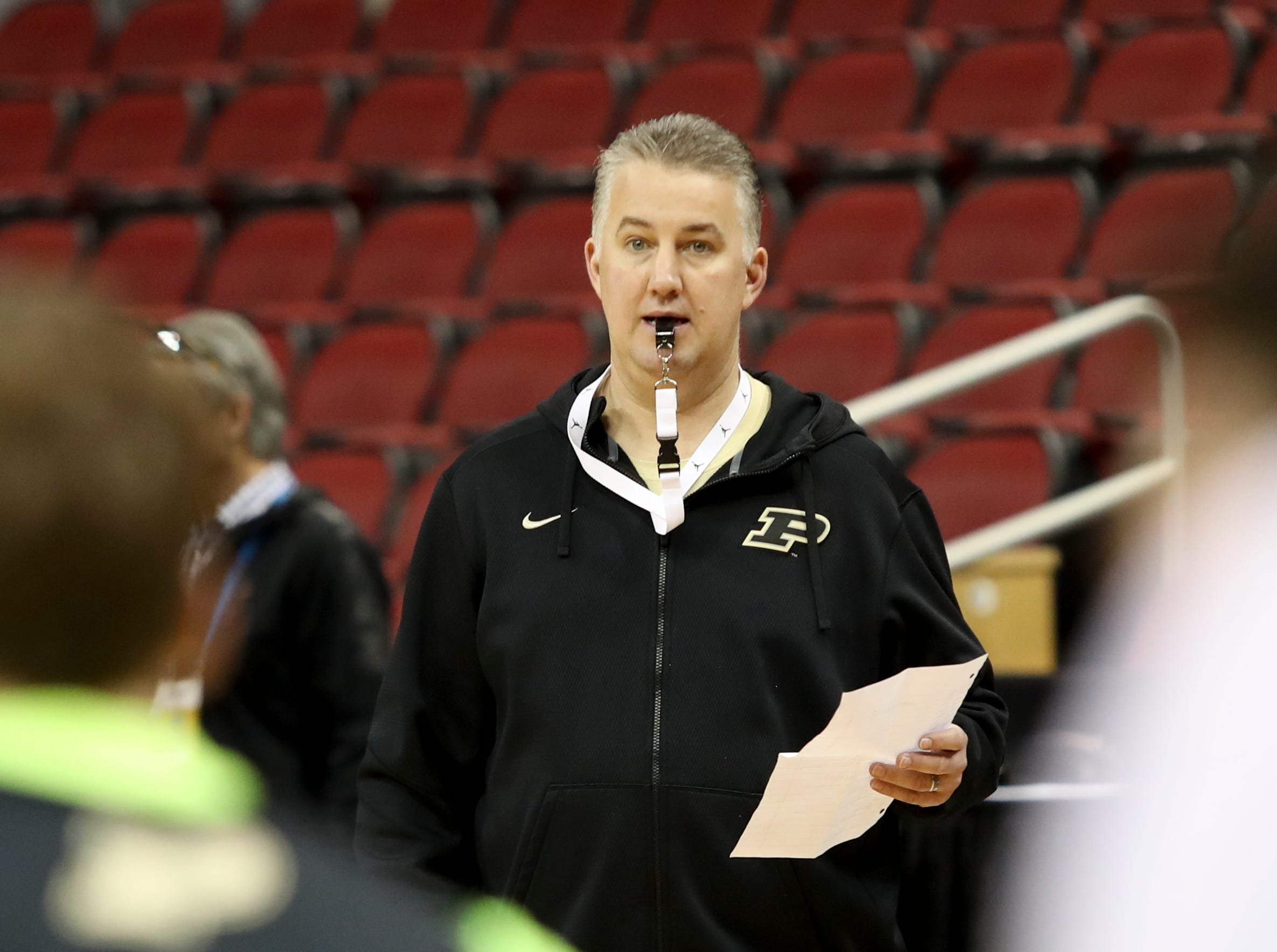 Purdue's coach Matt Painter leads practice on March 27 at the KFC Yum Center in Louisville, Ky.