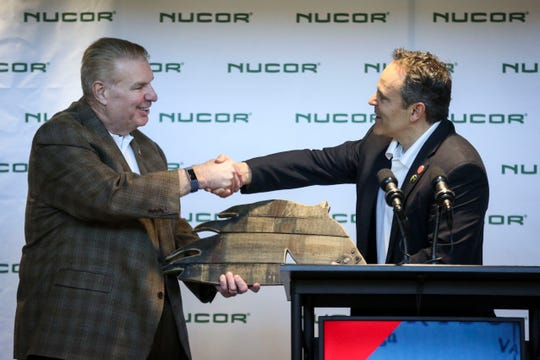 Gov. Matt Bevin, right, presents Nucor CEO and president John Ferriola a horse made out of bourbon barrel wood at Meade County College and Career Center after an announcement that Nucor Corp. will invest $1.35 billion in a Meade County steel mill project, expecting to create 400 jobs in Brandenburg, Ky. on Tuesday, March 27, 2019.