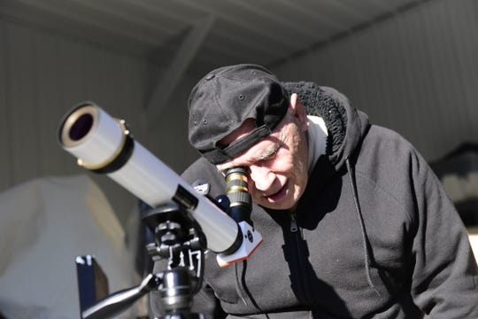 Keith Bowersock, of Stow, looks at the sun through a solar telescope at the Warren Rupp Observatory.