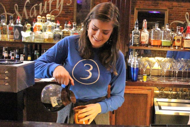 Lily Johnston worked at Tres last year. The restaurant owes her more than $8,000 in back wages and damages, the Ohio Department of Commerce found after she filed a minimum wage complaint.