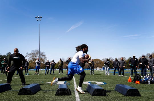 Running back Darrell Henderson runs through agility drills during Memphis' Pro Day on March 27, 2019.