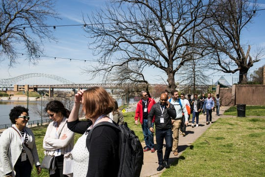 """People walk toward Cossitt Library during the Civic Commons Fourth Bluff tour on March 27, 2019. Memphis is one of five cities taking part in """"Reimagining the Civic Commons,"""" a national initiative aimed at reviving and connecting different features in each city."""