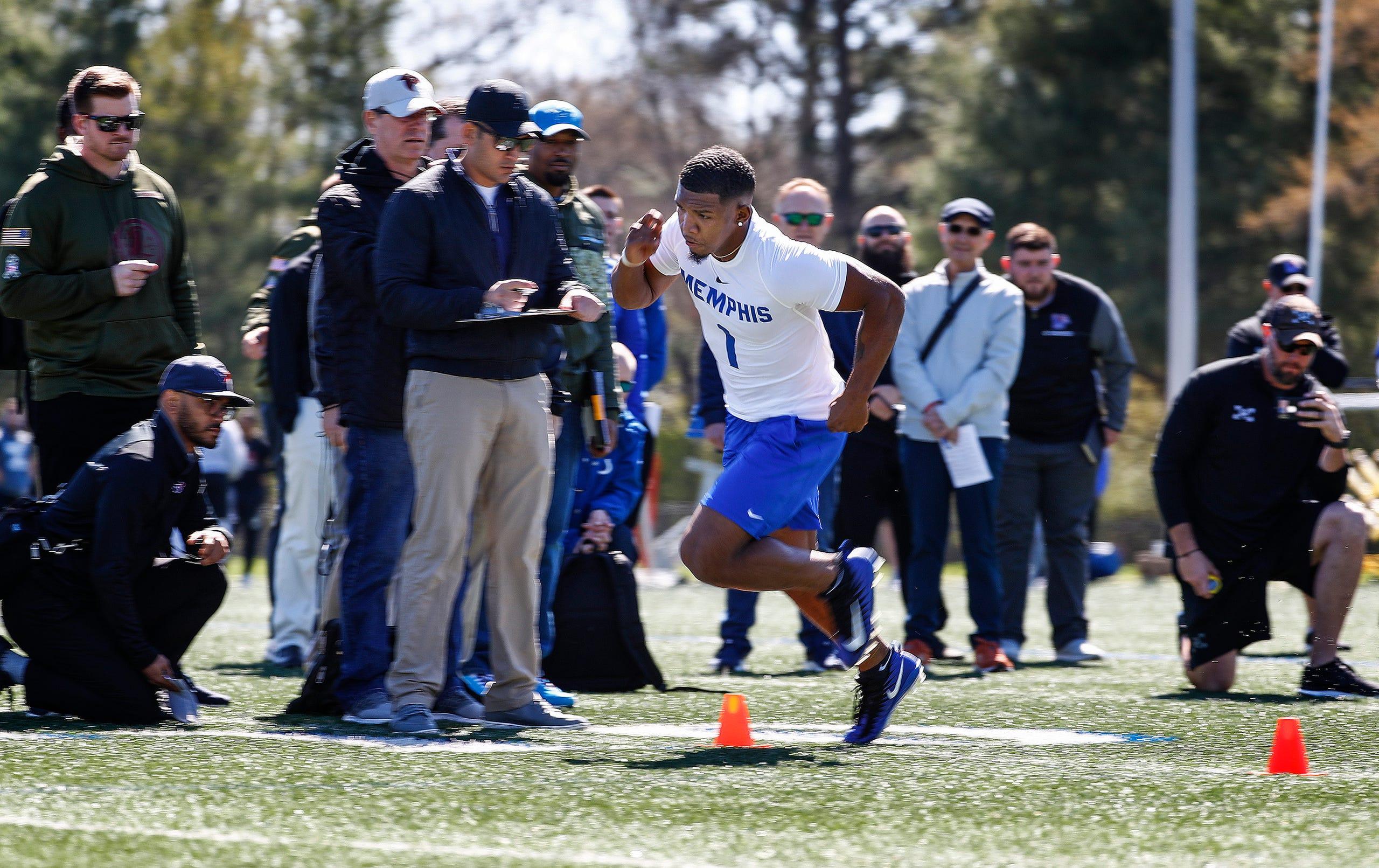 fd0788b52 Running back Tony Pollard runs through agility drills during Memphis'  football Pro Day on South