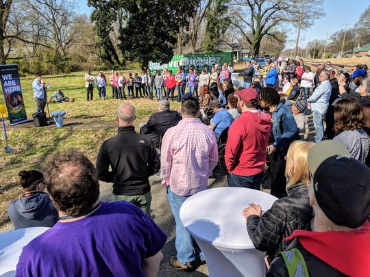 Community leaders and representatives of OUTMemphis gather for a groundbreaking on the nonprofit's youth emergency shelter Saturday.