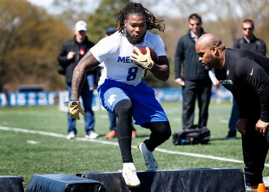 Running back Darrell Henderson runs through agility drills during Memphis' football Pro Day on South Campus, Wednesday, March 27, 2019.