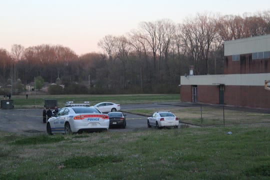 Officers outside the scene of a shooting near Chickasaw Middle School on Tuesday evening.
