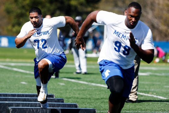 Trevon Tate (left) runs through agility drills during Memphis' football Pro Day on South Campus, Wednesday, March 27, 2019.