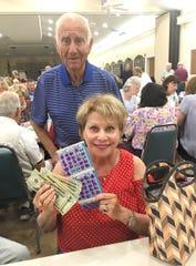 Bingo winner Jamie Satz with JCMI Bingo committee member Dr. Herb Kern.