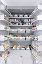 Gwyneth Paltrow's professionally organized pantry makes ample use of fashionably gray baskets and clear glass jars.