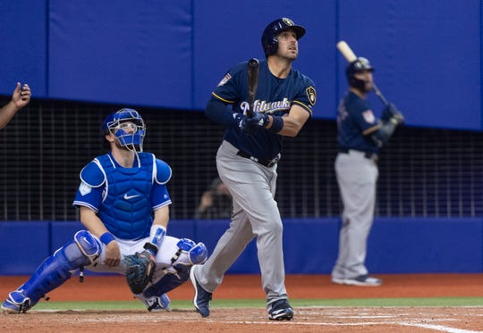 Milwaukee Brewers' Travis Shaw and Toronto Blue Jays catcher Danny Jansen watch  Shaw's three-run home run during the fifth inning of an exhibition baseball game Monday, March 25, 2019, in Montreal. (Paul Chiasson/The Canadian Press via AP) ORG XMIT: PCH106