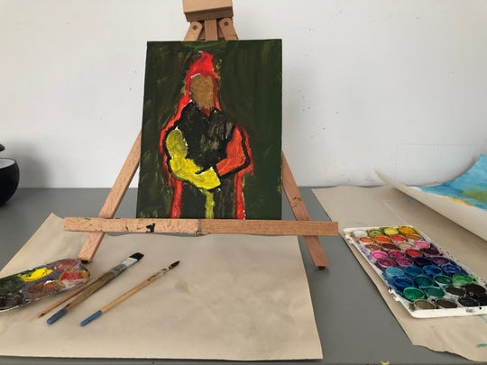 A client's artwork sits on an easel in the art therapy room at Milwaukee's Crisis Resource Center.