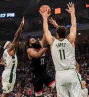 The defense of Brook Lopez and Eric Bledsoe helped the Bucks hold Houston's James Harden to 23 points Tuesday night.