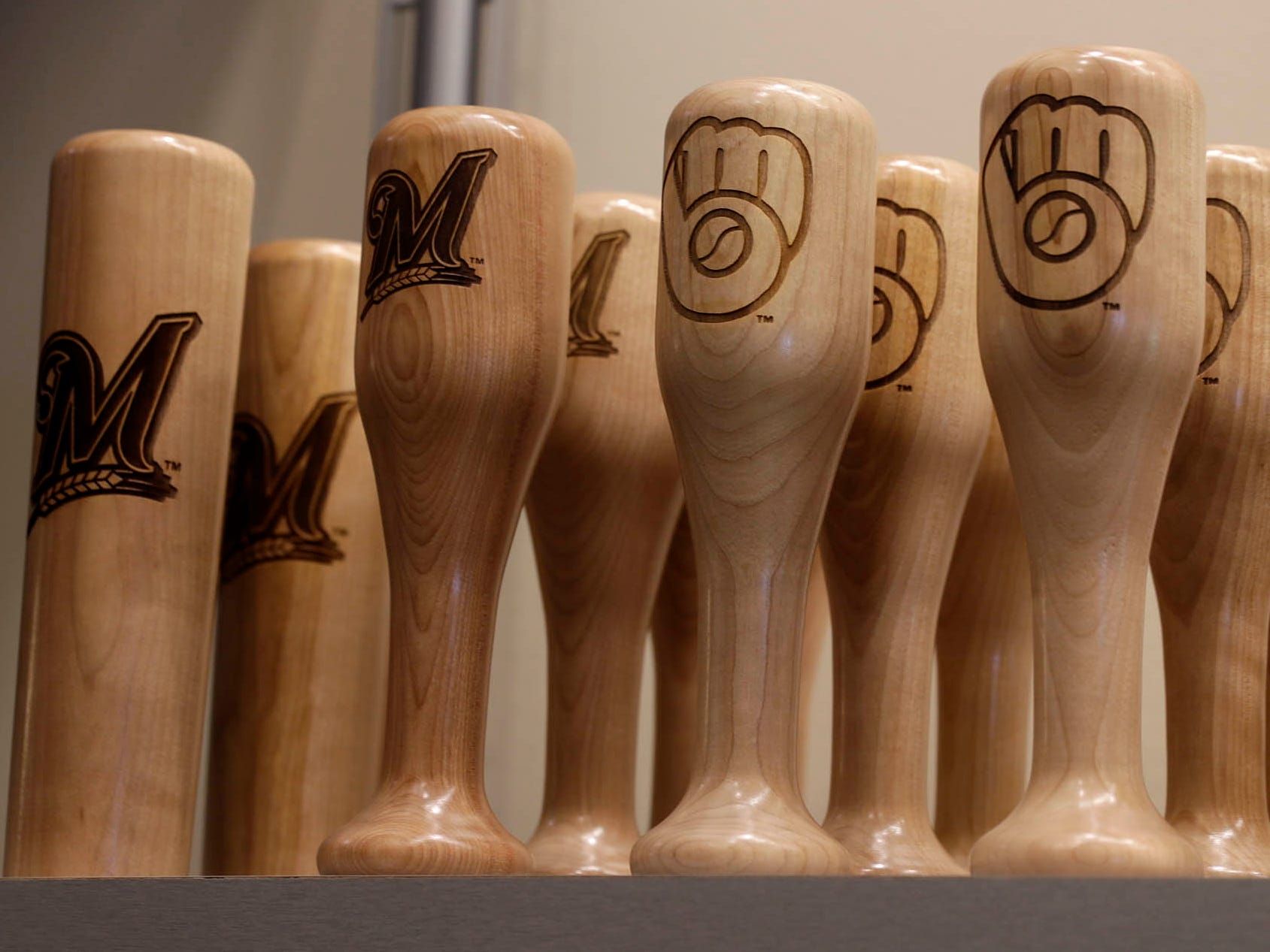 Drink mugs made from hollowed out bats are one of the new items for sale at the Milwaukee Brewers team store at Miller Park.