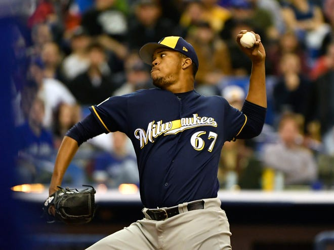 Brewers pitcher Angel Perdomo pitches in the eighth inning Tuesday night.