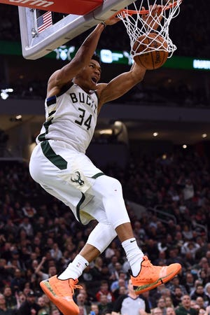 Giannis Antetokounmpo finishes off a dunk Tuesday night.