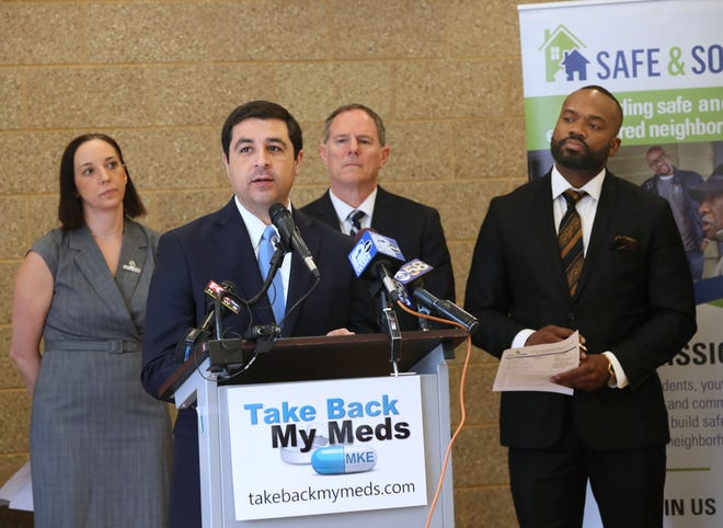 """Attorney General Josh Kaul speaks about  efforts to combat opiate abuse.  At rear from left are, Katie Sanders of Safe & Sound; Jon Richards, coalition director of """"Take Back My Meds MKE""""; and Ald. Russell Stamper."""