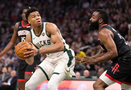 Bucks forward Giannis Antetokounmpo looks to shoot over James Harden.