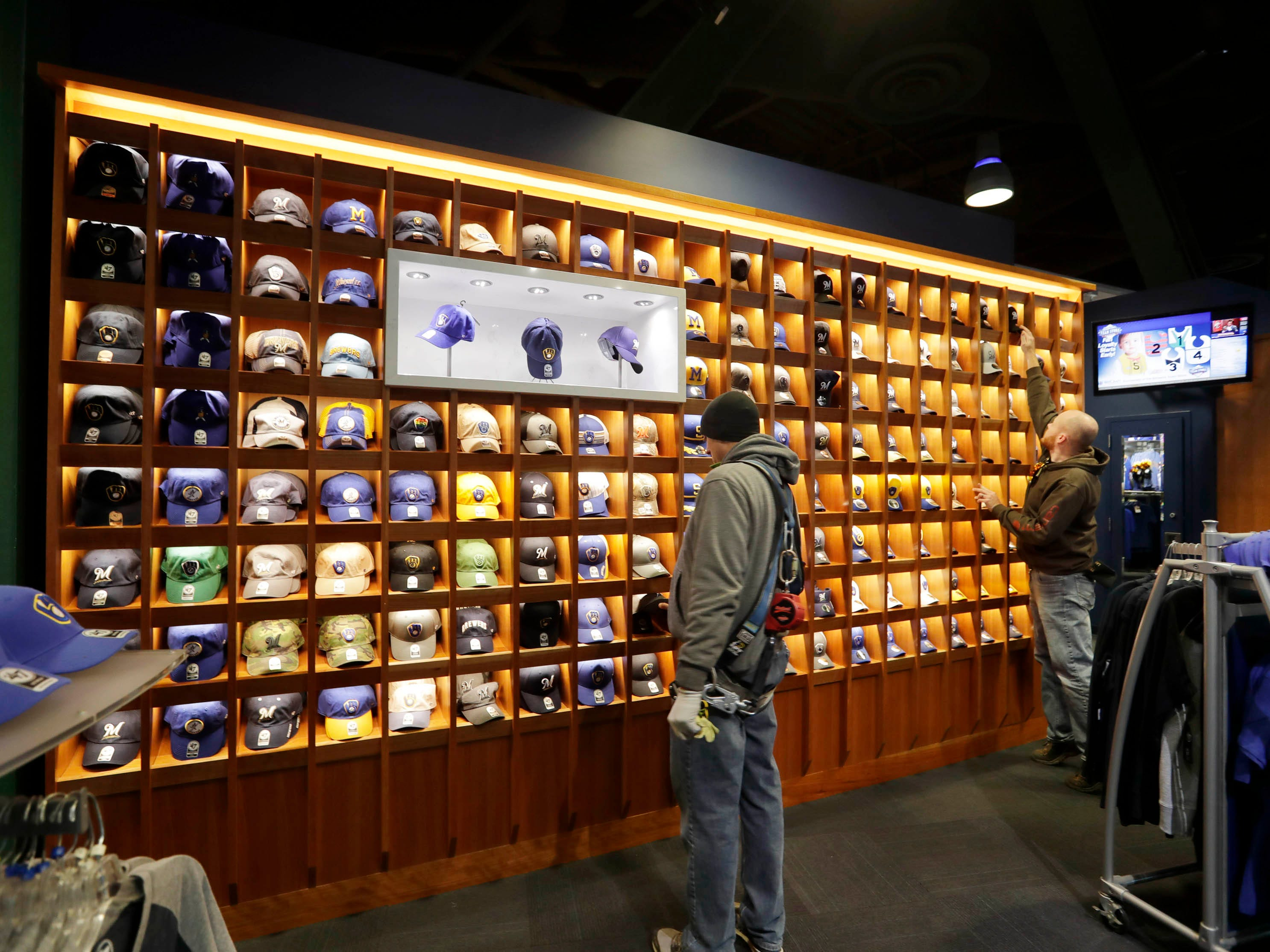 A new display wall features baseball caps at the Milwaukee Brewers team store at Miller Park. The Brewers are  taking over the operations of the merchandise and clothing stores for the 2019 season.