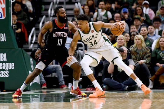 Giannis Antetokounmpo, right, and the Bucks open their regular season against the Rockets and James Harden on Thursday in Houston.