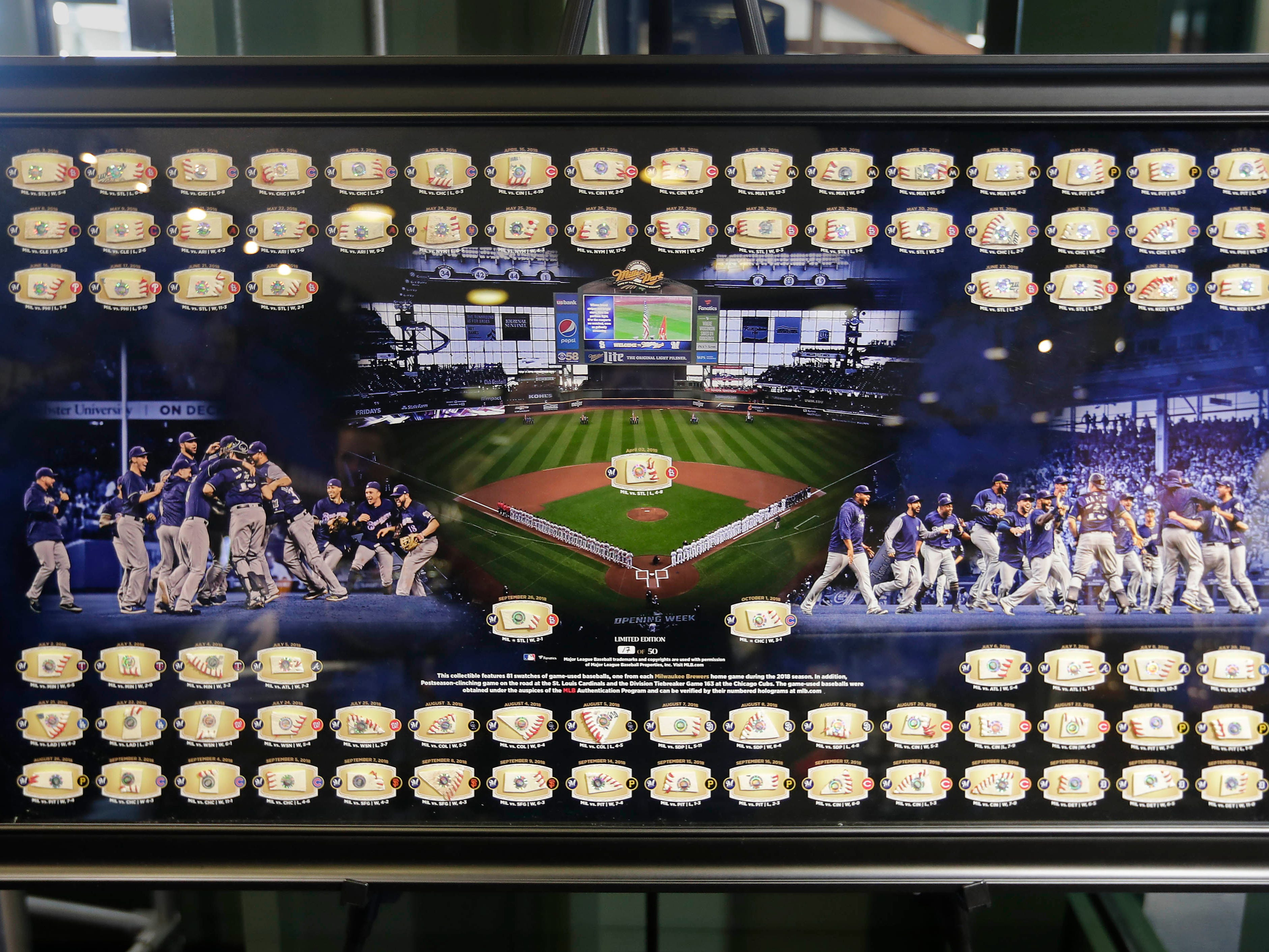 A limited edition framed souvenir includes a piece of a game ball from each home game last season. It sells for $350.