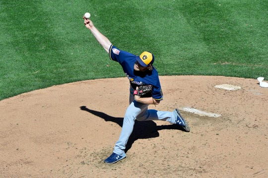 Corbin Burnes, who went 7-0 with a 2.61 ERA as a reliever last season, is one of three youngsters who will be part of the Brewers' starting rotation.