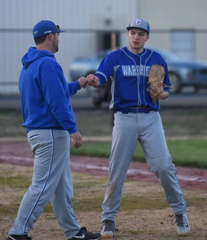 Cotter pitcher Cole Adams is congratulated by coach Jarod Jefferson on Tuesday against Decatur.