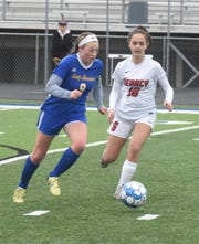Mountain Home's Emma Jones races downfield in a recent match against Searcy. The Lady Bombers toppled Jonesboro 9-1 on Tuesday night.