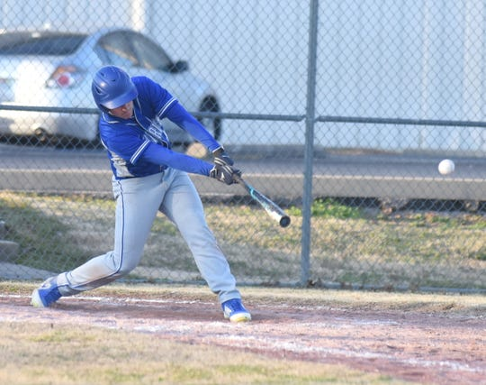 Cotter's Jackson Evans reaches for a base hit against Decatur on Tuesday.