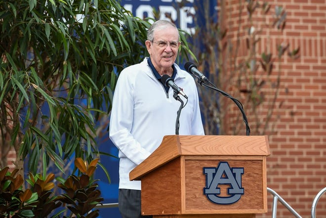 Former Auburn coach Sonny Smith speaks at the unveiling of the Charles Barkley statue at Auburn Arena.