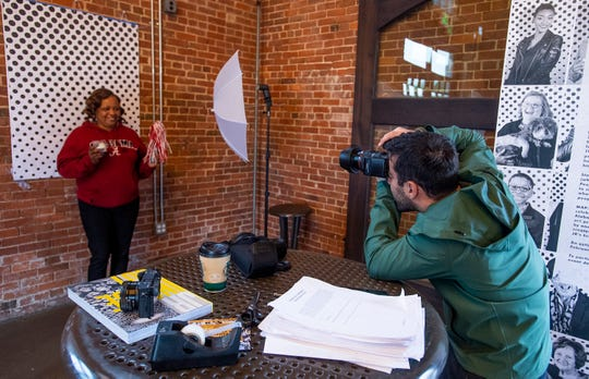 Sina Jasteh takes a picture of Hattie Abner during an Inside Out photo session at Riverwalk Stadium on March 26.