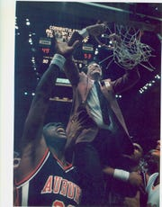 Sonny Smith cuts down the nets after Auburn won the SEC Tournament championship in 1985.