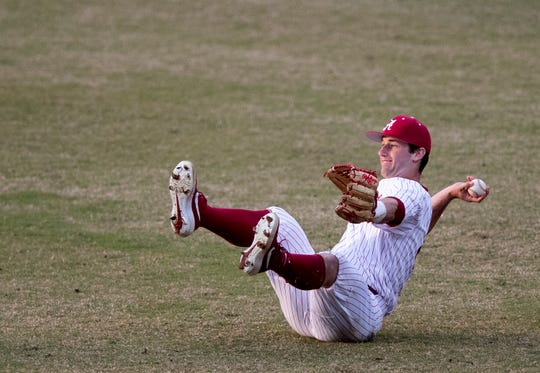 Alabama's Tyler Gentry (28) throws the ball to the infield from a sitting position after making a catch against Auburn at the MAX Capital City Classic at Riverwalk Stadium in Montgomery, Ala., on Tuesday March 26, 2019.