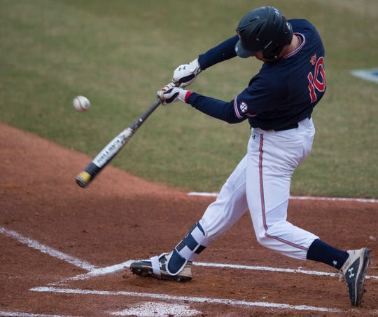 Auburn's Edouard Julien (10) hits the ball during the Auburn-Alabama Capital City Classic at Riverwalk Stadium in Montgomery, Ala., on Tuesday, March 26, 2019. Alabama defeated Auburn 6-3.