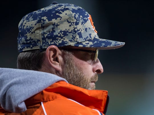 Auburn head baseball coach Butch Thompson watches his team from the dugout during the Auburn-Alabama Capital City Classic at Riverwalk Stadium in Montgomery, Ala., on Tuesday, March 26, 2019. Alabama defeated Auburn 6-3.