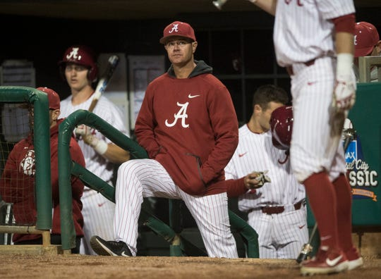 Alabama head baseball coach Brad Bohannon watches his team from the dugout during the Auburn-Alabama Capital City Classic at Riverfront Park in Montgomery, Ala., on Tuesday, March 26, 2019. Alabama defeated Auburn 6-3.