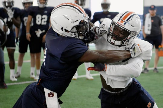 Auburn wide receiver Shedrick Jackson (left) and Roger McCreary (right) go through drills on Monday, March 25, 2019 in Auburn, Ala.