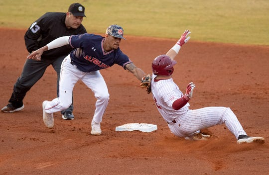 Auburn's Will Holland (17) tags out Alabama's Morgan McCullough (8) at second to finish of a double play during the MAX Capital City Classic at Riverwalk Stadium in Montgomery, Ala., on Tuesday March 26, 2019.
