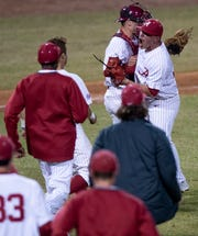 Alabama's Jeremy Randolph (23) hugs Alabama's Johnny Hawk (42) after throwing the last strike in the win over Auburn at the MAX Capital City Classic at Riverwalk Stadium in Montgomery, Ala., on Tuesday March 26, 2019.