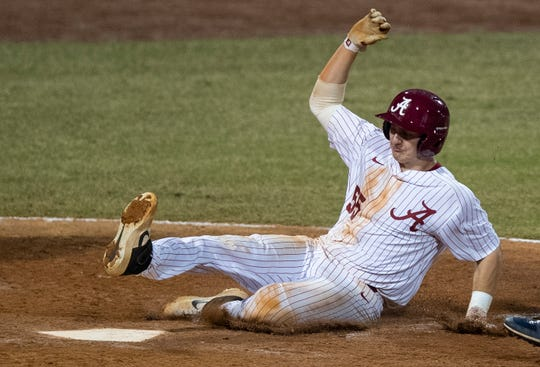Alabama's Drew Williamson (55) scores the go ahead run against Auburn in the eighth inning at the MAX Capital City Classic at Riverwalk Stadium in Montgomery, Ala., on Tuesday March 26, 2019.