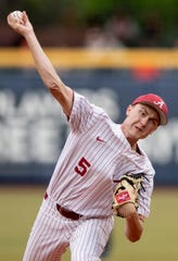 Alabama's Tyler Ras (5) pitches against Auburn at the MAX Capital City Classic at Riverwalk Stadium in Montgomery, Ala., on Tuesday March 26, 2019.