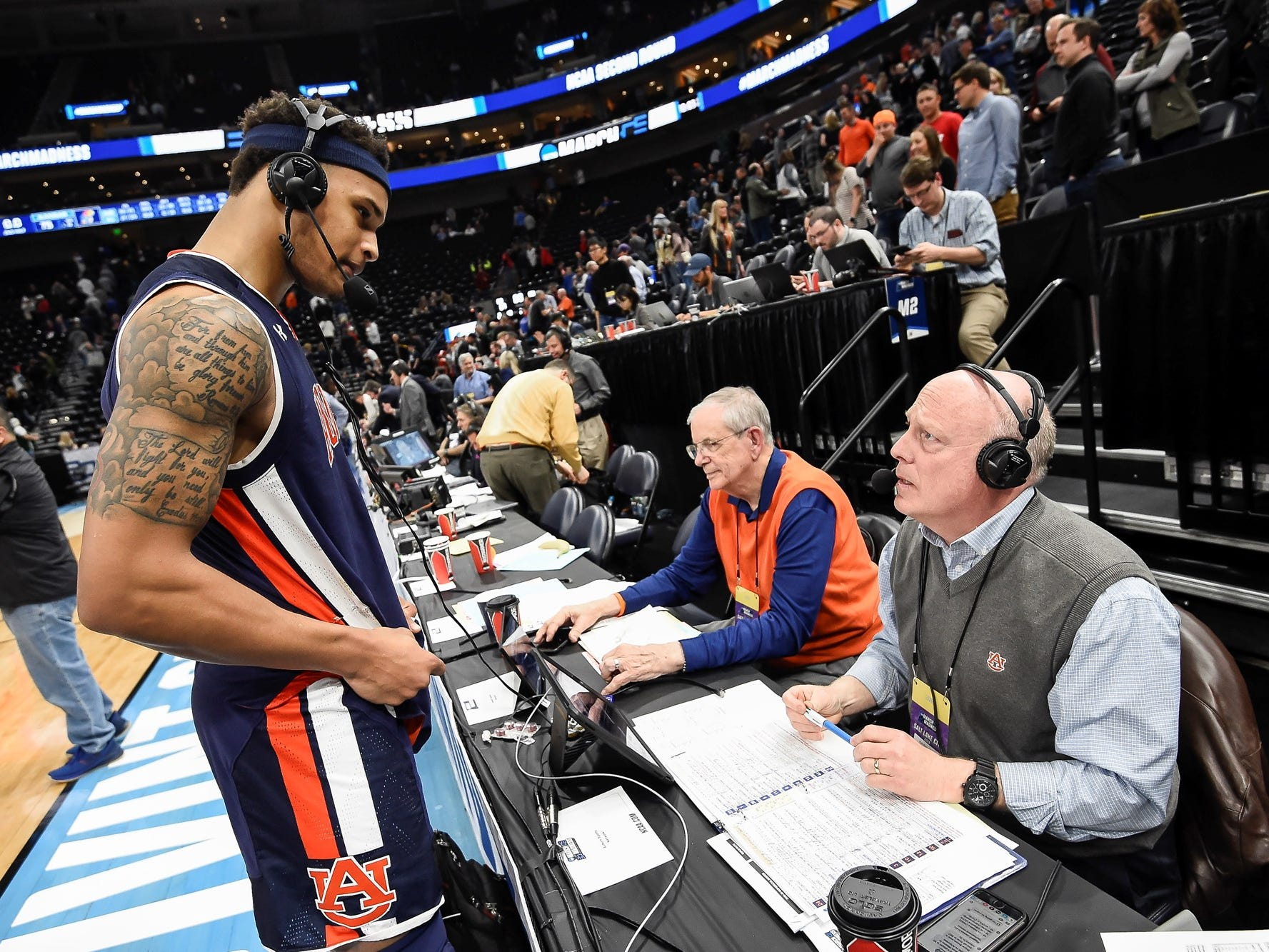 Auburn guard Bryce Brown (left) speaks to radio broadcast team Sonny Smith (center) and Rod Bramblett (right) during the second round of the NCAA Tournament in Salt Lake City.