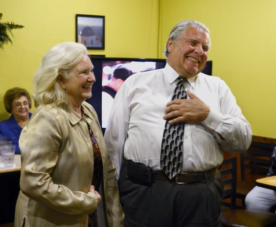 Dottie and Dimitri Polizos share a laugh with guests at Mr. G's Ristorante in Montgomery after learning he'll be in the election runoff in 2013.